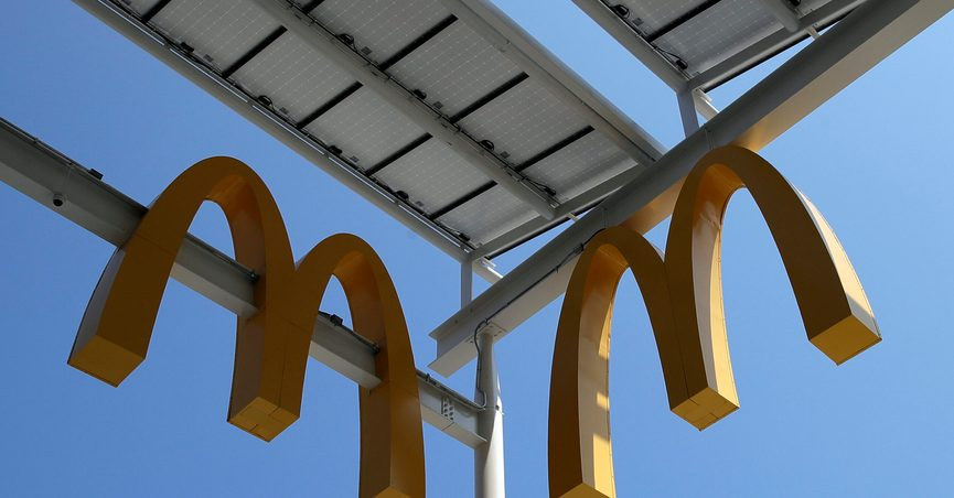 FILE- This Aug. 8, 2018, photo shows logos of McDonald's Chicago flagship restaurant. McDonald's is raising pay at 650 company-owned stores in the U.S. as part of its push to hire thousands of new workers in a tight labor market. The fast food giant is the latest restaurant chain to announce pay raises. (AP Photo/Nam Y. Huh, File)