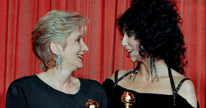"""FILE - In this Jan. 24, 1988 file photo, Actress Olympia Dukakis, winner of a Golden Globe for """"Best Performance in a Supporting Role"""" and Cher, winner of the """"Best Performance by an Actress in a musical or comedy"""", hold the awards they received for performances in the hit movie """"Moonstruck"""" at the Beverly Hilton Hotel. Olympia Dukakis, the veteran stage and screen actress whose flair for maternal roles helped her win an Oscar as Cher's mother in the romantic comedy """"Moonstruck,"""" has died. She was 89. (AP Photo/Reed Saxon, File)"""
