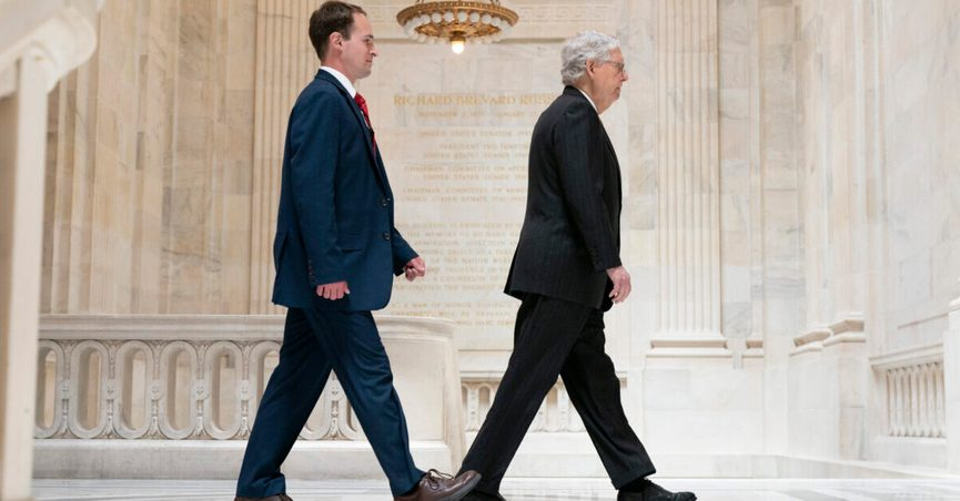 Senate Minority Leader Mitch McConnell of Ky., right, walks with a staffer, Tuesday, May 18, 2021, to a meeting with Senate Republicans on Capitol Hill in Washington. (AP Photo/Jacquelyn Martin)
