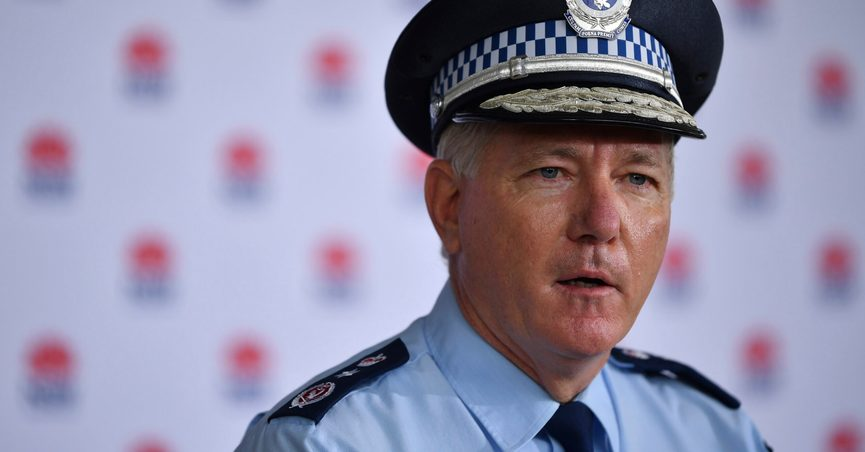 New South Wales Police Commissioner Mick Fuller speaks to media during a COVID-19 update in Sydney, Monday, June 28, 2021. Two naked men were rescued by emergency services from an Australian forest after they were startled by a deer while nude sunbathing on a beach and became lost, police say. (Joel Carrett/AAP Image via AP)