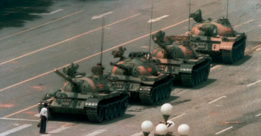 """FILE - In this June 5, 1989 file photo, a man stands alone to block a line of tanks heading east on Beijing's Cangan Blvd. in Tiananmen Square. Microsoft Corp. blamed """"accidental human error"""" for its Bing search engine briefly not showing image results for the search term """"tank man"""" on the anniversary of the bloody military crackdown in Beijing's Tiananmen Square in 1989. Users in different parts of the world, including the U.S., said Friday, June 4, 2021 that no image results were returned when they searched for the term """"tank man."""" (AP Photo/Jeff Widener, File)"""