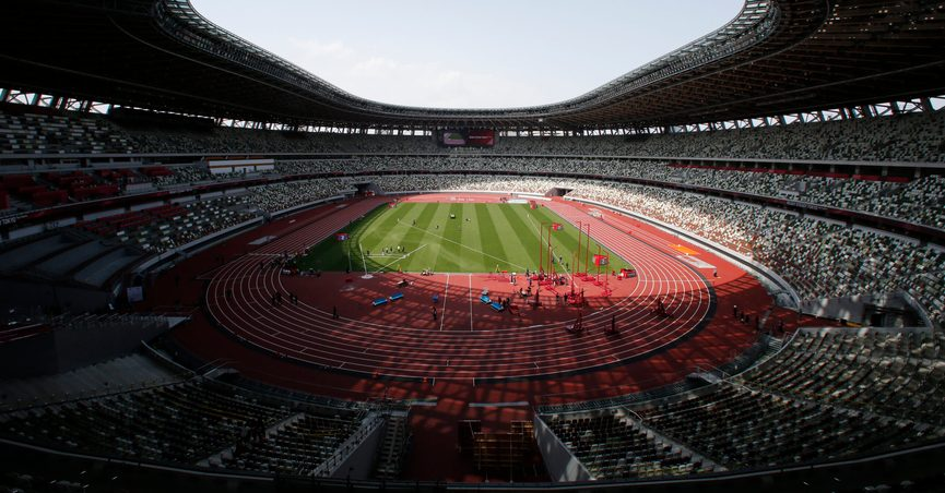 FILE - In this May 9, 2021, file photo, a general view of National Stadium during an athletics test event for the Tokyo 2020 Olympics Games in Tokyo. IOC officials say the Tokyo Olympics will open on July 23 and almost nothing now can stop the games from going forward. (AP Photo/Shuji Kajiyama, File)