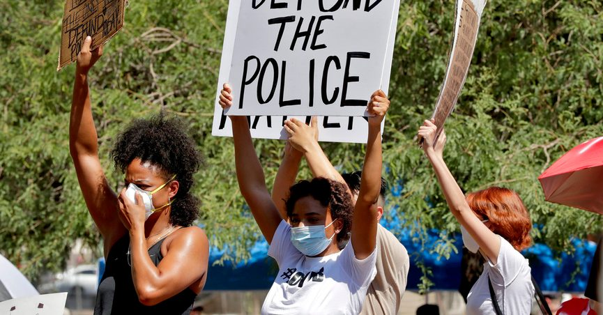 FILE - In this June 3, 2020, file photo, protesters rally in Phoenix, demanding the Phoenix City Council defund the Phoenix Police Department, following the death of George Floyd. Some Republican-controlled states have responded to persistent calls for police reform by moving in the other direction. An Associated Press review of legislation found that states where lawmakers pushed back against the police-reform movement included Arizona, Florida, Iowa, Oklahoma, Tennessee and Wyoming. (AP Photo/Matt York, File)