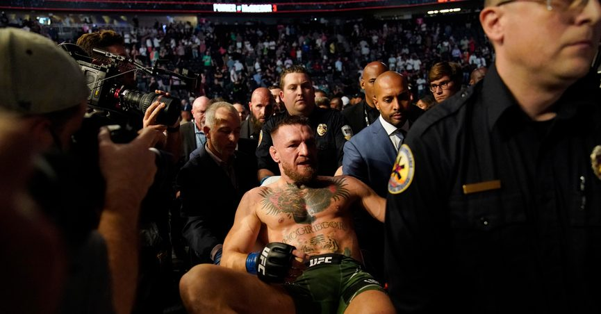 Conor McGregor is carried off on a stretcher after losing to Dustin Poirier in a UFC 264 lightweight mixed martial arts bout Saturday, July 10, 2021, in Las Vegas. (AP Photo/John Locher)