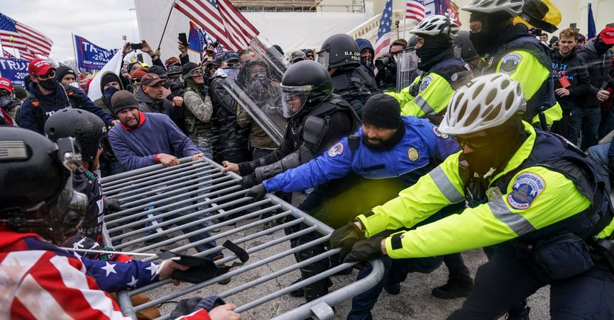 FILE - In this Jan. 6, 2021, file photo violent insurrectionists loyal to President Donald Trump hold on to a police barrier at the Capitol in Washington. A New Jersey gym owner on Friday became the first person to plead guilty to assaulting a law enforcement officer during the Jan. 6 riot at the U.S. Capitol. (AP Photo/John Minchillo, File)