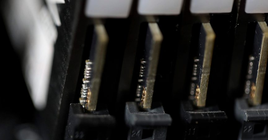 FILE - This Feb 23, 2019, file photo shows the inside of a computer in Jersey City, N.J. The Biden administration will offer rewards up to $10 million for information leading to the identification of foreign state-sanctioned malicious cyber activity against critical U.S. infrastructure, including ransomware attacks. The administration is launching the website stopransomware.gov to offer the public resources for countering the threat. (AP Photo/Jenny Kane, File)