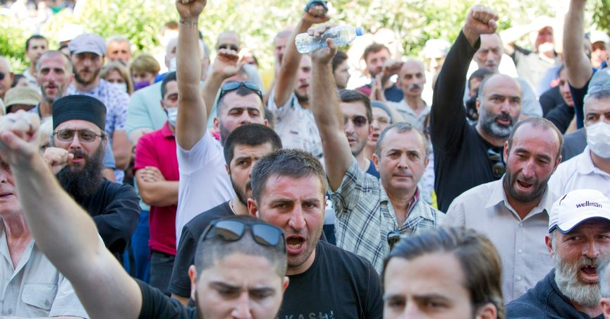 Opponents of the march shout as they block off the capital's main avenue to an LGBT march in Tbilisi, Georgia, Monday, July 5, 2021. A protest against a planned LGBT march in the Georgian capital turned violent on Monday as demonstrators attacked journalists. Organizers of the Tbilisi March For Dignity that was to take place in the evening cancelled the event, saying authorities had not provided adequate security guarantees. (AP Photo/Shakh Aivazov)