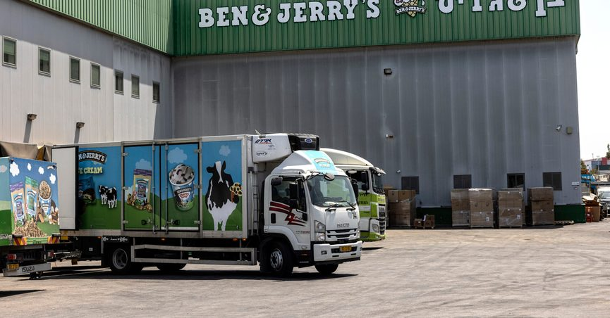 """Truck are parked at the Ben & Jerry's ice-cream factory in the Be'er Tuvia Industrial area, Tuesday, July 20, 2021. Israeli Prime Minister Naftali Bennett told the head of Unilever on Tuesday that Israel will """"act aggressively"""" against Ben & Jerry's over the subsidiary's decision to stop selling its ice cream in the Israeli-occupied West Bank and contested east Jerusalem. (AP Photo/Tsafrir Abayov)"""