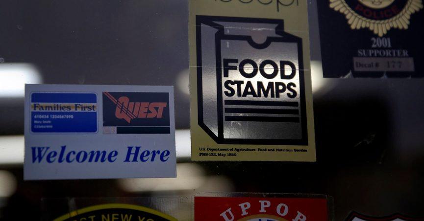FILE - In this Jan. 12, 2015 file photo, a supermarket displays stickers indicating they accept food stamps in West New York, N.J. The Biden administration has approved a significant and permanent increase in the levels of food stamp assistance available to needy families—the largest single increase in the program's history. Starting in October 2021, average benefits for food stamps (officially known as the SNAP program) will rise more than 25 percent above pre-pandemic levels. (AP Photo/Seth Wenig, File)