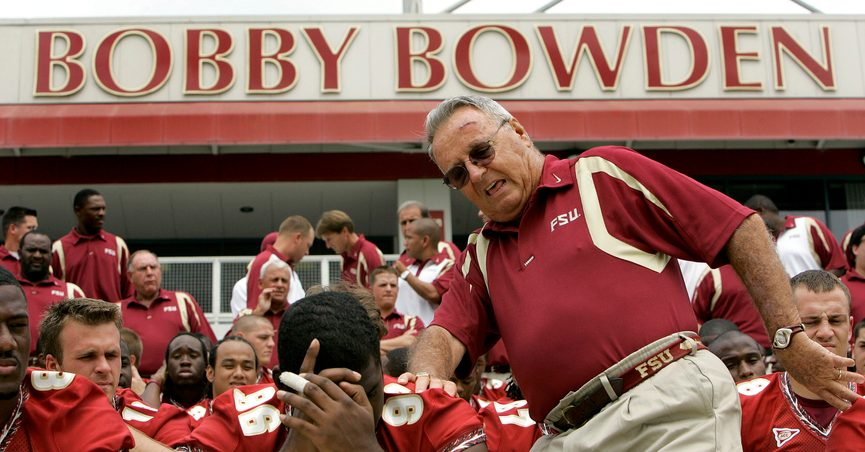 FILE - In this Aug. 12, 2007, file photo, Florida State head football coach Bobby Bowden, right, squeezes into his seat for a team photo during media day activities in Tallahassee, Fla. The Hall of Fame college football coach Bobby Bowden has died after a battle with pancreatic cancer. Exuding charm and wit, Bowden led Florida State to two national championships and a record of 315-98-4 during his 34 seasons with the Seminoles. In all, Bowden had 377 wins during his 40 years in major college coaching. He was 91 years old. (AP Photo/Phil Coale, File)