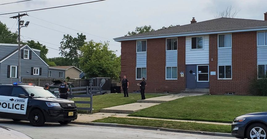 Kenosha police investigate a shooting at 40th Avenue and 45th Street on the city's north side Tuesday, Aug. 10, 2021, in Kenosha, Wis. A 19-year-old woman was using a handgun's laser sight as a cat toy when she accidentally shot a friend, according to prosecutors. The 19-year-old woman was charged Thursday with injury by negligent use of a weapon. (Terry Flores/The Kenosha News via AP)