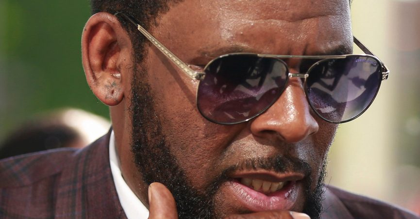 FILE - This photo from Wednesday June 26, 2019, shows R&B singer R. Kelly arriving at the Leighton Criminal Court in Chicago for arraignment on sex-related charges. Federal prosecutors in New York on Friday, July 23, 2021 asked a judge for permission to admit more evidence for which Kelly has not been charged, at his upcoming sex-trafficking trial in Brooklyn. (AP Photo/Amr Alfiky, File)