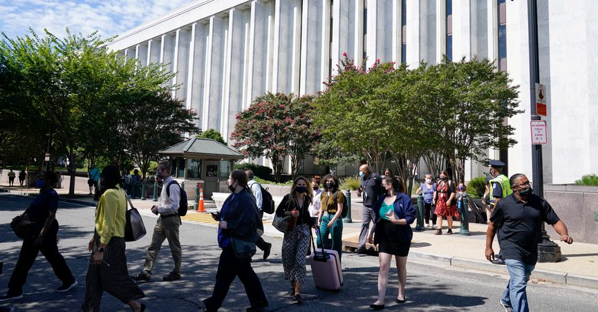 People are evacuated from the James Madison Memorial Building, a Library of Congress building, in Washington on Thursday, Aug. 19, 2021, as law enforcement investigate a report of a pickup truck containing an explosive device near the U.S. Capitol. (AP Photo/Alex Brandon)