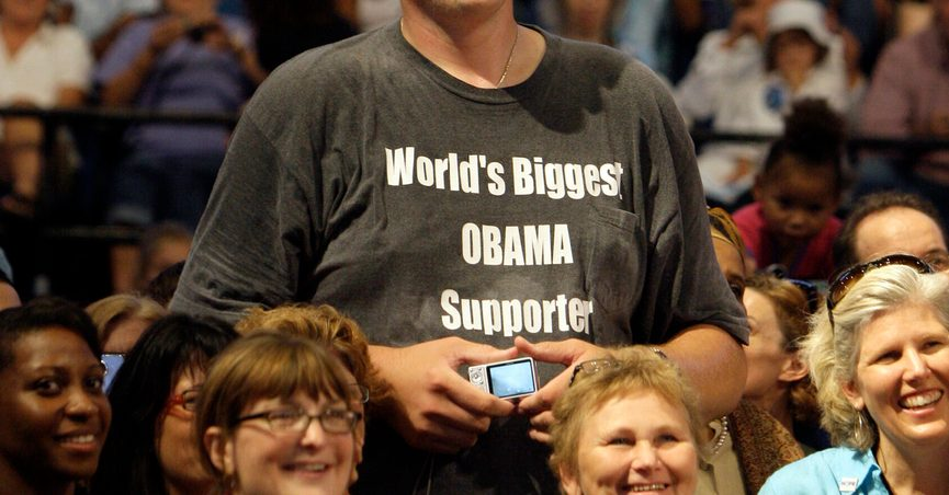 FILE - In this Sept. 12, 2009 file photo, Igor Vovkovinskiy, 27, of Rochester, Minn, standing 7-feet and 8-inches tall, listens to President Barack Obama, not pictured, during a health insurance reform rally in Minneapolis. Vovkovinskiy, the tallest man in the United States, has died in Minnesota. He was 38. His family says the Ukrainian-born Vovkovinskiy died of heart disease Friday, Aug. 20, 2021, at the Mayo Clinic in Rochester. (AP Photo/Haraz N. Ghanbari, File)