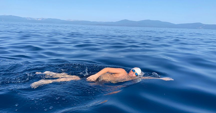 This Aug. 1, 2021 image provided by Jillian Savage shows James Savage, 14, of Los Banos, Calif. as he swam the entire 21.3-mile length of Lake Tahoe from South Lake Tahoe, California to Incline Village, Nevada. He became the youngest person ever to make the swim and complete the coveted Tahoe Triple Crown. He completed the two other legs of the triple crown earlier, each 10 miles are longer. (AP Photo/By Jillian Savage)