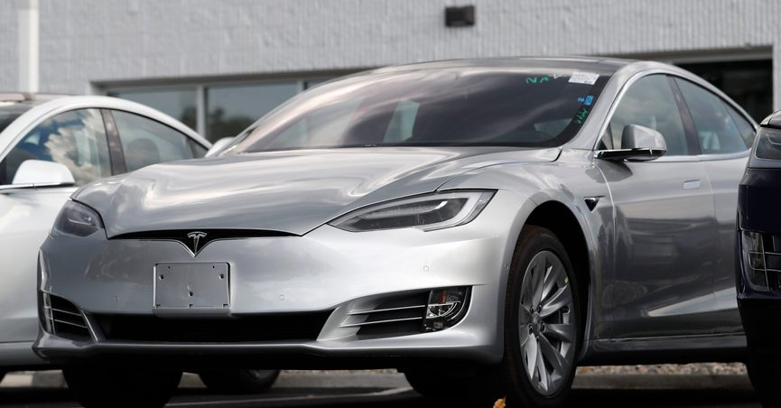 FILE - This July 8, 2018, file photo shows Tesla 2018 Model 3 sedans sitting on display outside a Tesla showroom in Littleton, Colo. The U.S. government has opened a formal investigation into Tesla's Autopilot partially automated driving system, saying it has trouble spotting parked emergency vehicles. The National Highway Traffic Safety Administration announced the action Monday, Aug. 16, 2021, in a posting on its website. (AP Photo/David Zalubowsi, File)