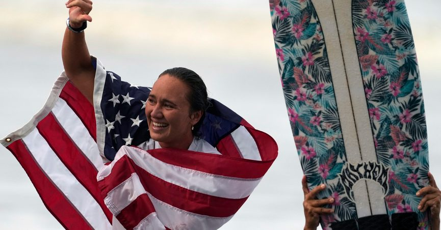 FILE - In this July 27, 2021, file photo, Carissa Moore, of the United States, celebrates winning the gold medal in the women's surfing competition at the 2020 Summer Olympics at Tsurigasaki beach in Ichinomiya, Japan. The first Olympic gold medalist for surfing, Moore, is the only Native Hawaiian surfer at the Games. (AP Photo/Francisco Seco, File)