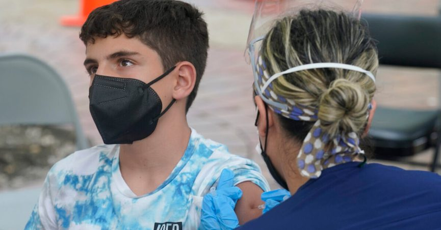 Andres Veloso, 12, gets the first dose of the Pzifer COVID-19 vaccine, Monday, Aug. 9, 2021, in Miami. Florida is reporting a surge of COVID-19 cases caused by the highly contagious delta variant. (AP Photo/Marta Lavandier)