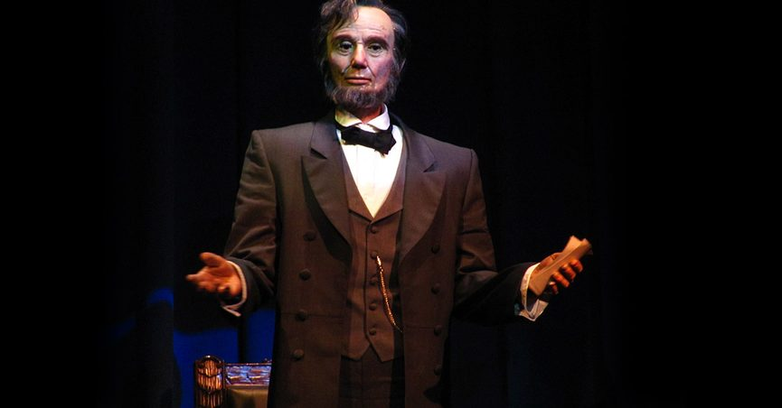 The Abraham Lincoln animatronic partially collapsed and folded forward at Walt Disney World Resort at the Magic Kingdom at the Hall of Presidents attraction.