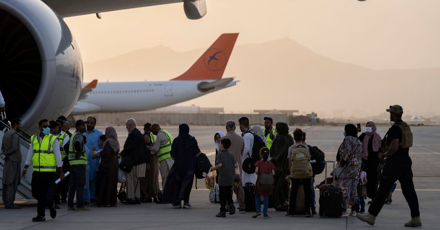 Foreigners board a Qatar Airways aircraft at the airport in Kabul, Afghanistan, Thursday, Sept. 9, 2021. Some 200 foreigners, including Americans, flew out of Afghanistan on an international commercial flight from Kabul airport on Thursday, the first such large-scale departure since U.S and foreign forces concluded their frantic withdrawal at the end of last month. (AP Photo/Bernat Armangue)