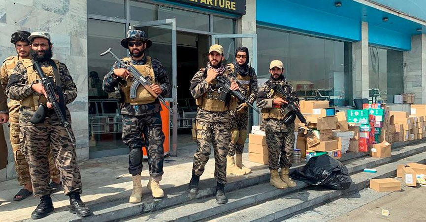 FILE - In this Aug. 31, 2021 file photo, Taliban fighters stand guard inside the Hamid Karzai International Airport after the U.S. withdrawal in Kabul, Afghanistan. Taliban authorities will allow between 100 and 150 Americans to fly out from Kabul in the coming hours, Qatari officials said on Thursday, Sept. 9, 2021, marking the airport's first such flight since U.S. forces withdrew from the country. The large group of foreigners, including Americans and other Westerners, would depart Thursday on a Qatar Airways flight that had earlier ferried humanitarian aid to the country, officials said. (AP Photo/Kathy Gannon, File)