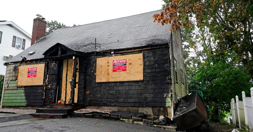 A home that was seriously damaged by fire is seen, Tuesday, Sept. 28, 2021, in Melrose, Mass. WBZ-TV reported that the $399,000 asking price for the home in Melrose, a suburb of Boston, is evidence of how hot the housing market is in the state. The online listing for the burned, three bedroom, 1,857-square foot home says it is in need of complete renovation and is being sold as is. (AP Photo/Elise Amendola)