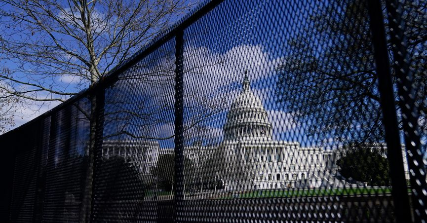 FILE - In this April 2, 2021, file photo, the U.S. Capitol is seen behind security fencing on Capitol Hill in Washington. Law enforcement concerned by the prospect for violence at a rally in the nation's Capitol next week are planning to reinstall protective fencing that surrounded the U.S. Capitol for months after the Jan. 6 insurrection there, according to a person familiar with the discussions. (AP Photo/Carolyn Kaster, File)