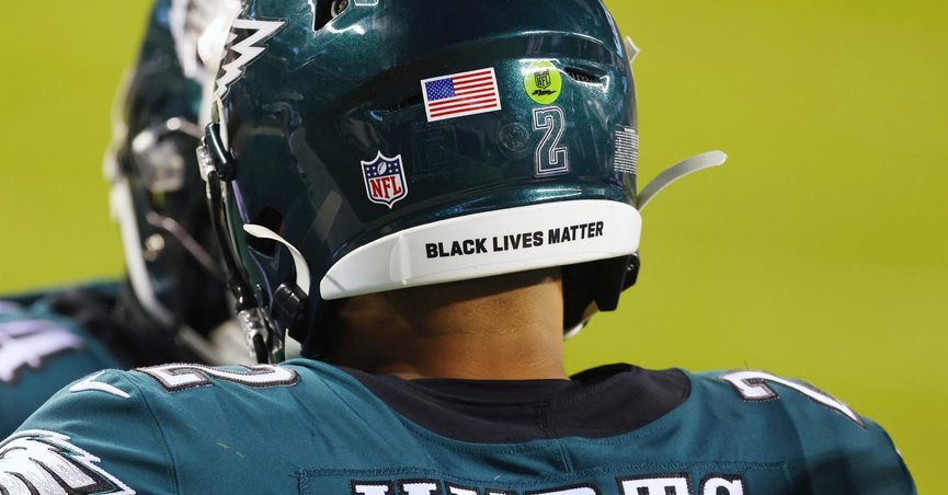 """FILE - In this Jan. 3, 2021, file photo, Philadelphia Eagles Jalen Hurts wears a Black Lives Matter decal on the back of his helmet during the team's NFL football game against the Washington Football Team in Philadelphia. NFL players can wear social justice messages on their helmets again this season and """"It Takes All of Us"""" and """"End Racism"""" will be stenciled in end zones for the second straight year as part of the league's Inspire Change platform. (AP Photo/Rich Schultz, File)"""