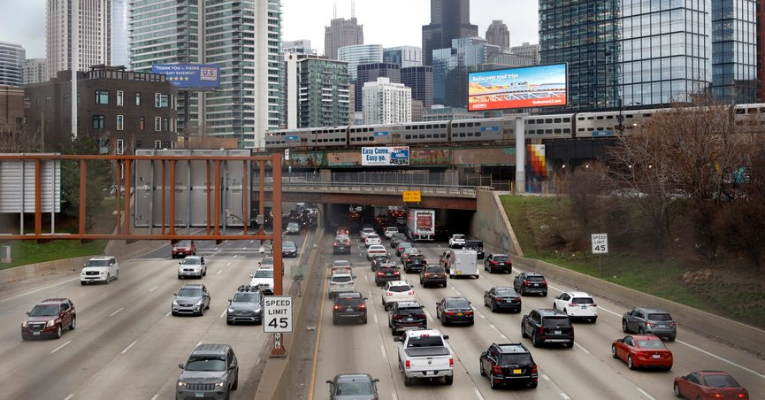 FILE - In this March 31, 2021 file photo, traffic flows along Interstate 90 highway as a Metra suburban commuter train moves along an elevated track in Chicago. The government's road safety agency reported Thursday, Sept. 2, that U.S. traffic deaths in the first quarter of 2021 rose by 10.5% over last year, even as driving has declined. (AP Photo/Shafkat Anowar, File)