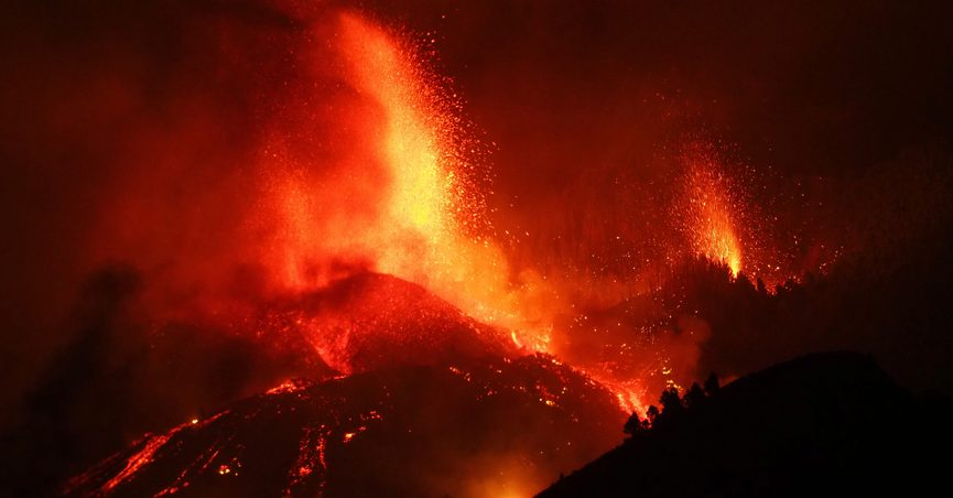 Lava flows from an eruption of a volcano near El Paso on the island of La Palma in the Canaries, Spain, Sunday, Sept. 19, 2021. Lava continues to flow slowly from a volcano that erupted in Spain's Canary Islands off northwest Africa. The head of the islands' regional government says Monday he expects no injuries to people in the area after some 5,000 were evacuated. (Europa Press via AP)