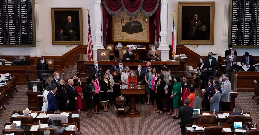 FILE - In this May 5, 2021, file photo, Texas state Rep. Donna Howard, D-Austin, center at lectern, stands with fellow lawmakers in the House Chamber in Austin, Texas, as she opposes a bill introduced that would ban abortions as early as six weeks and allow private citizens to enforce it through civil lawsuits, under a measure given preliminary approval by the Republican-dominated House. A Texas law banning most abortions in the state took effect at midnight on Sept. 1 but the Supreme Court has yet to act on an emergency appeal to put the law on hold. If allowed to remain in force, the law would be the most dramatic restriction on abortion rights in the United States since the high court's landmark Roe v. Wade decision legalized abortion across the country in 1973. (AP Photo/Eric Gay, File)