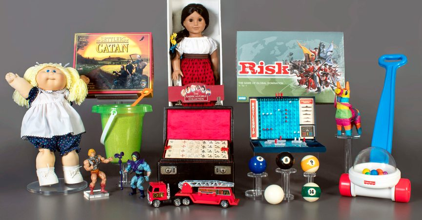 This photo provided by the National Toy Hall of Fame in Rochester, N.Y. shows the finalists being considered for induction into the hall later this year. The finalists are: American Girl Dolls, Battleship, billiards, Cabbage Patch Kids, Fisher-Price Corn Popper, Mahjong, Masters of the Universe, piñata, Risk, sand, The Settlers of Catan, and toy fire engine. The winners will be chosen by a panel of experts and inducted on Nov. 4, 2021. (National Toy Hall of Fame via AP)