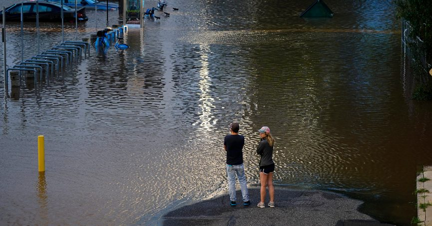 People view a flooded street in Philadelphia, Thursday, Sept. 2, 2021 in the aftermath of downpours and high winds from the remnants of Hurricane Ida that hit the area. (AP Photo/Matt Rourke)