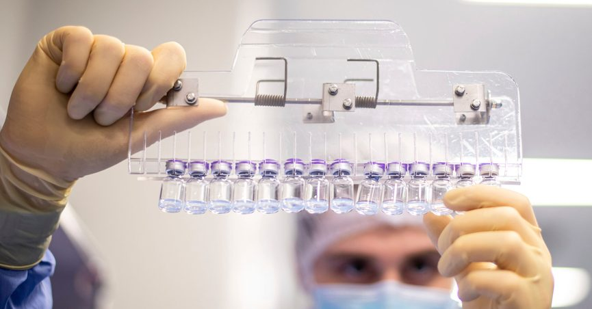 FILE - In this March 2021 photo provided by Pfizer, a technician inspects filled vials of the Pfizer-BioNTech COVID-19 vaccine at the company's facility in Puurs, Belgium. Pfizer and Moderna have filed FDA applications for booster doses but the government will decide on extra Johnson & Johnson doses later, once that company shares its booster data with the agency. (Pfizer via AP)