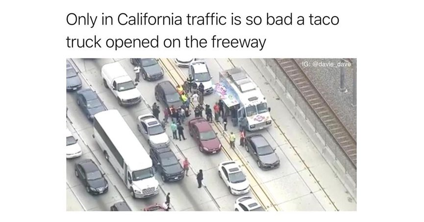 A taco truck opened on the freeway in California traffic.