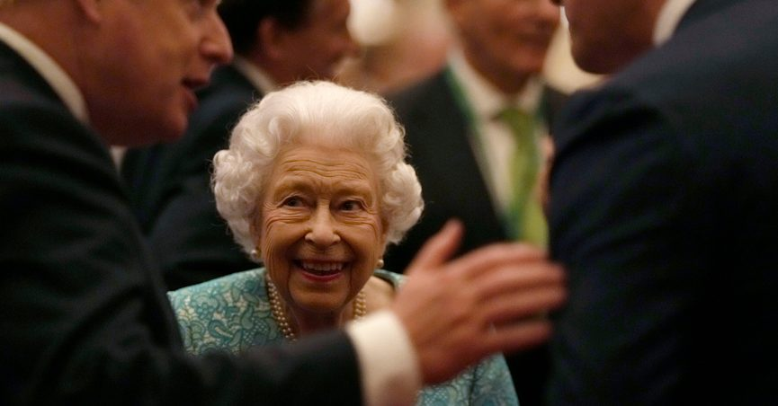 Britain's Queen Elizabeth II and Prime Minister Boris Johnson, left, greet guests at a reception for the Global Investment Summit in Windsor Castle, Windsor, England, Tuesday, Oct. 19, 2021. (AP Photo/Alastair Grant, Pool)