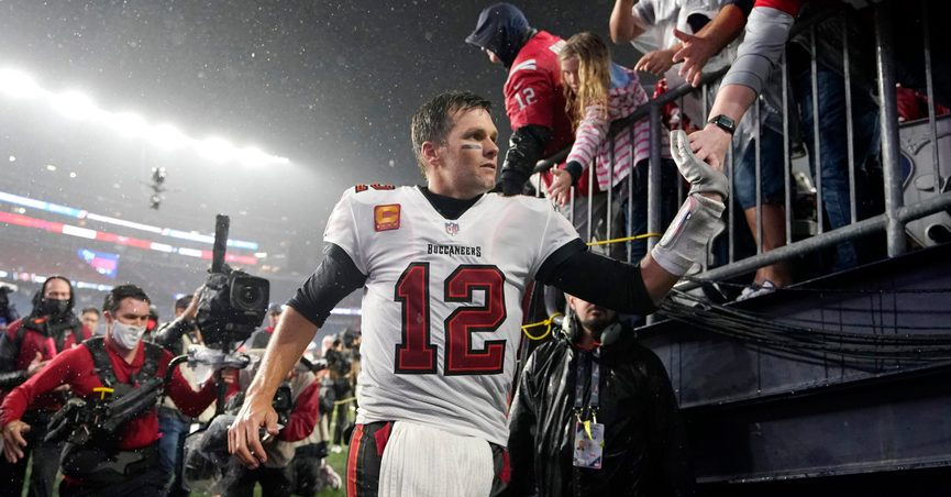 Tampa Bay Buccaneers quarterback Tom Brady (12) is congratulated by fans after defeating the New England Patriots 19-17 in an NFL football game, Sunday, Oct. 3, 2021, in Foxborough, Mass. (AP Photo/Steven Senne)