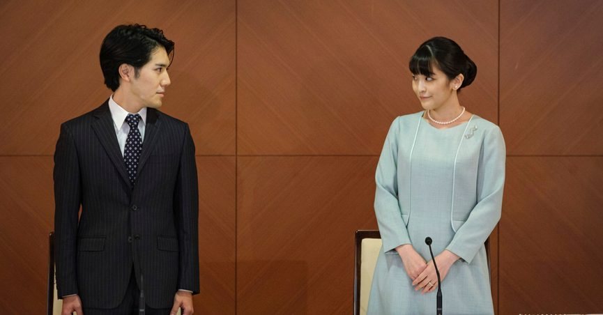 Japan's former Princess Mako, right, the elder daughter of Crown Prince Akishino and Crown Princess Kiko, and her husband Kei Komuro, look at each other during a press conference to announce their marriage at a hotel in Tokyo, Japan Tuesday, Oct. 26, 2021. Former Princess Mako married the commoner and lost her royal status Tuesday in a union that has split public opinion after a three-year delay caused by a financial dispute involving her new mother-in-law. (Nicolas Datiche/Pool Photo via AP)
