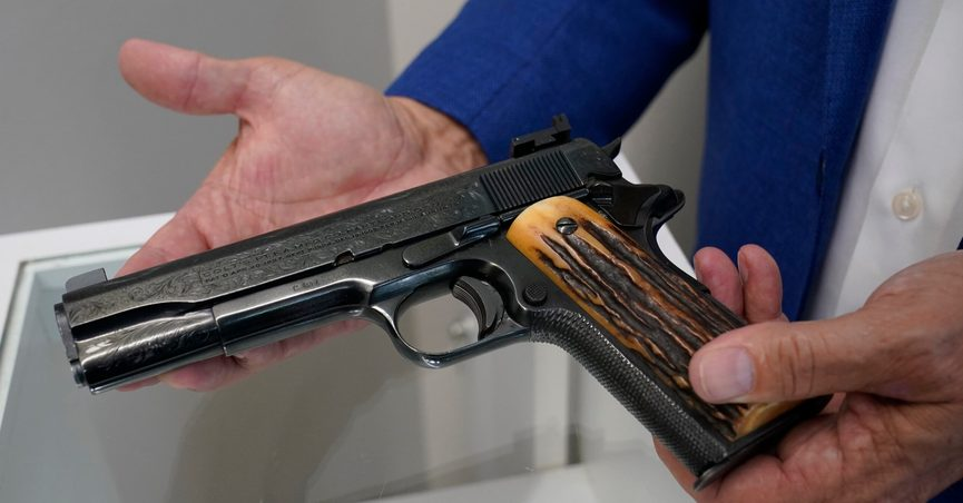 FILE - In this Aug. 25, 2021 file photo, Brian Witherell displays a Colt .45-caliber pistol that once belonged to mob boss Al Capone, at Witherell's Auction House in Sacramento, Calif. The infamous Chicago gangster may have died nearly 75 years ago, but it's clear interest in him is very much alive after some of his prized possessions were auctioned off over the weekend for at least $3 million. (AP Photo/Rich Pedroncelli, File)