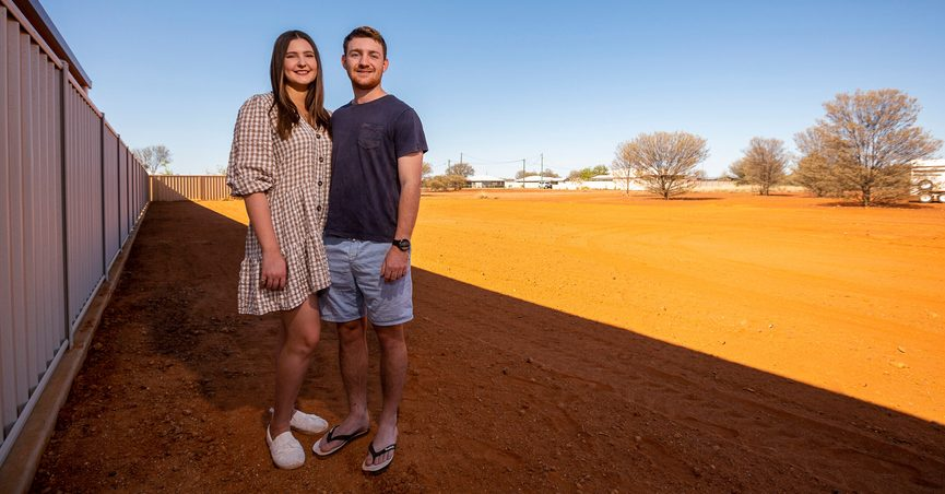 Tom Hennessy, right, and his fiancee Tessa McDougall stand on their land in the Australian Outback town of Quilpie, on Oct. 2, 2021. Quilpie had hoped its offer of a free residential block of land to anyone who would make it their home might attract five new families to the remote community of 800. But authorities have been overwhelmed by more than 250 enquires in less than two weeks from around Australia and internationally. (Leon O'Neil via AP)
