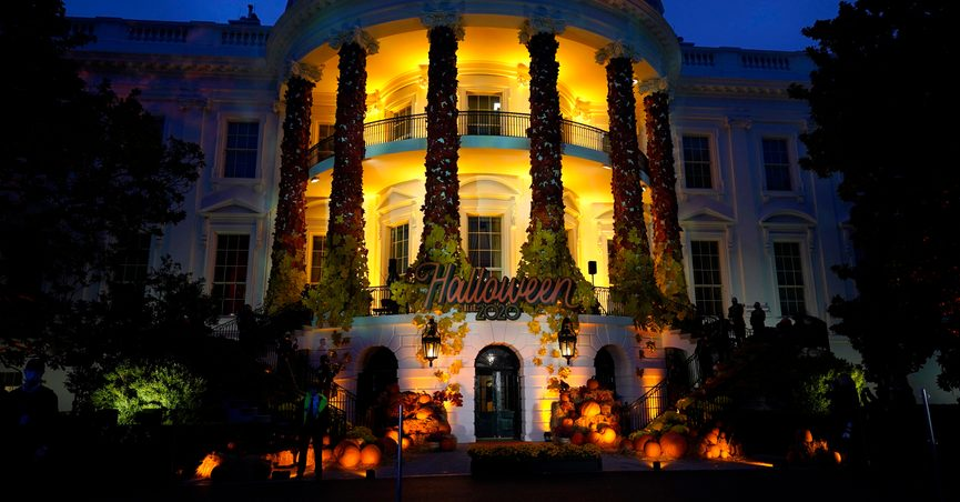 FILE - In this Oct. 25, 2021 file photo, the South Lawn of the White House is lit during a Halloween celebration at the White House in Washington. Ghosts and goblins can scratch the White House from their trick or treating routes this year. President Joe Biden and first lady Jill Biden will be in Europe on Halloween and won't be around to help hand out candy and other treats. Instead, the first lady's spokesperson says the Pennsylvania Avenue side of the White House will be lit up in orange to celebrate the spooky holiday. (AP Photo/Manuel Balce Ceneta)