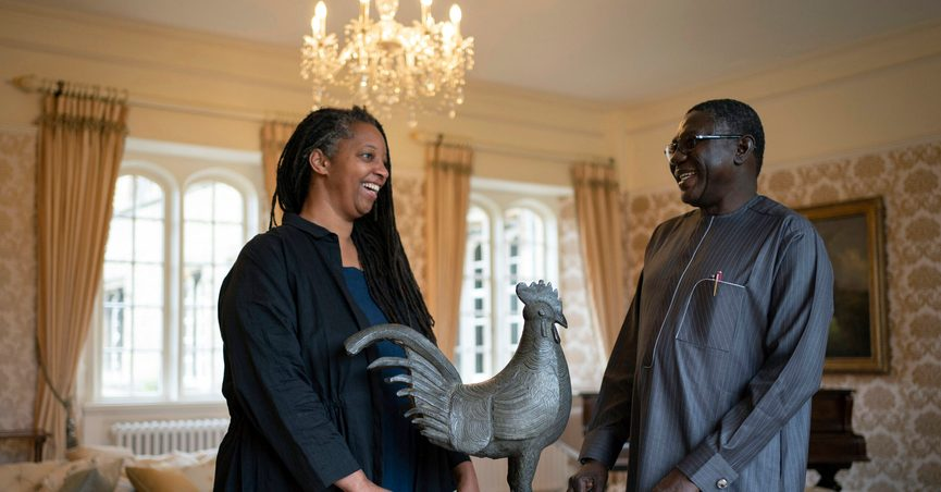 Master of Jesus College Sonita Alleyne, left and Director General of Nigeria's National Commission for Museums and Monuments Professor Abba Isa Tijani pose for a photo ahead of a ceremony at Jesus College Cambridge, where the looted bronze cockerel, known as the Okukur, will be returned to Nigeria, in Cambridge, England, Wednesday, Oct. 27, 2021. Jesus College announced in 2019 that it would return the Okukor, a statue that was taken from the Court of Benin in what is now Nigeria by British colonial forces in 1897. (Joe Giddens/PA via AP)