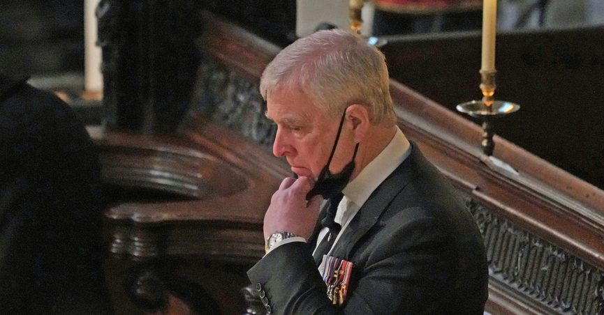 FILE - Britain's Prince Andrew stands inside St. George's Chapel during the funeral of his father, Prince Philip, at Windsor Castle, Windsor, England, Saturday April 17, 2021. British police said Sunday, Oct. 10, 2021 that they will not be taking any further action against Prince Andrew after a review prompted by a Jeffrey Epstein accuser who claims that he sexually assaulted her. (Yui Mok/Pool via AP, File)