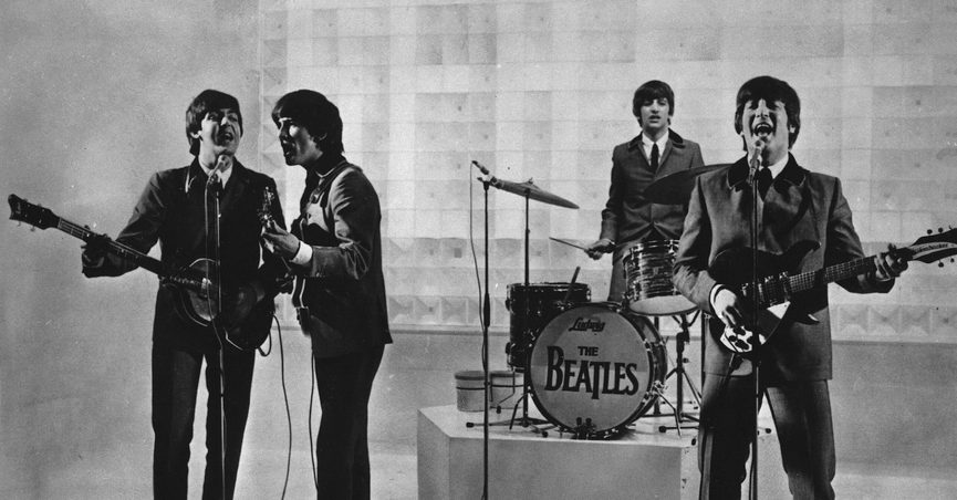 """FILE - The Beatles are seen performing, date unknown. From left to right: Paul McCartney, George Harrison, Ringo Starr, and John Lennon. McCartney has revisited the breakup of The Beatles, refuting the suggestion that he was responsible for the group's demise. Speaking on an episode of BBC Radio 4's """"This Cultural Life'' that is scheduled to air Oct 23, McCartney said it was John Lennon who wanted to disband The Beatles. (AP Photo)"""