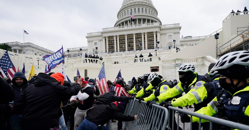 FILE - In this Jan. 6, 2021 file photo, Trump supporters try to break through a police barrier at the Capitol in Washington. A House committee tasked with investigating the Jan. 6 Capitol insurrection is moving swiftly to hold at least one of Donald Trump's allies, former White House aide Steve Bannon, in contempt. That's happening as the former president is pushing back on the probe in a new lawsuit. (AP Photo/Julio Cortez)