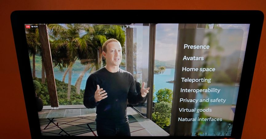"""Seen on the screen of a device in Sausalito, Calif., Facebook CEO Mark Zuckerberg delivers the keynote address during a virtual event on Thursday, Oct. 28, 2021. Zuckerberg talked up his latest passion -- creating a virtual reality """"metaverse"""" for business, entertainment and meaningful social interactions. (AP Photo/Eric Risberg)"""