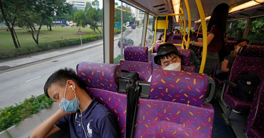 Passengers sleep on the upper deck of a double-decker bus in Hong Kong, Saturday, Oct. 16, 2021. Travel-starved, sleep-deprived residents might find a new Hong Kong bus tour to be a snooze. The 47-mile, five-hour ride on a double-decker bus around the territory is meant to appeal to people who are easily lulled asleep by long rides. (AP Photo/Kin Cheung)