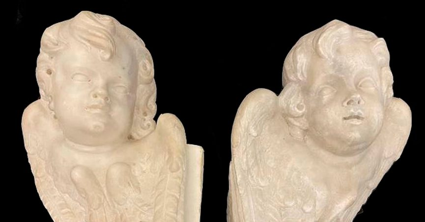 """Two marble statues of angels are seen in this undated image. A British art collector who bought a pair of 17th century marble angels from a Neapolitan antiques shop two decades ago and had them at his French home has returned the """"putti"""" to Italy's art police after learning that they had been stolen from a church. In a statement released Tuesday Oct. 19, 2021 Italy's carabinieri art police said the unnamed collector had tried to resell the angels at an antiques shop in Avignon, France ahead of his planned move from France to Portugal when French art police identified them as possible stolen goods. (Carabinieri for the Protection of Cultural Heritage via AP)"""
