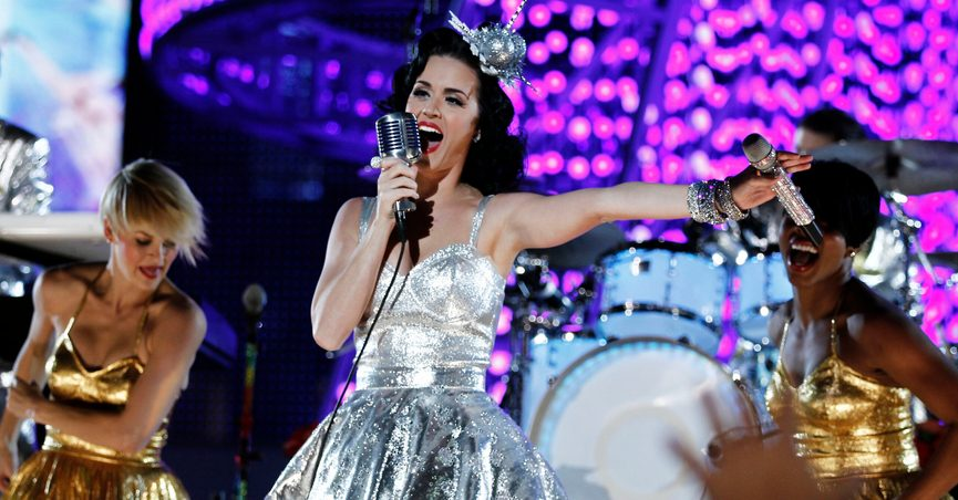 FILE - In this Nov. 30, 2010 file photo, Katy Perry performs during the Grammy Nominations Concert in Los Angeles. The silver dress Perry performed in is among a collection of items that will be sold to benefit the Recording Academy's MusiCares, which helps provide health and other safety net assistance for those who need it in the music industry. The sale, hosted by Julien's Auctions, will be held Jan. 30, 2022, during the runup to the Grammys. (AP Photo/Matt Sayles, File)