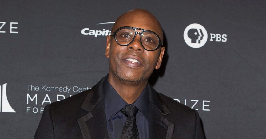 """FILE - Dave Chappelle arrives at the 22nd Annual Mark Twain Prize for American Humor on Oct. 27, 2019, in Washington, D.C. A top Netflix executive said Dave Chappelle's special """"The Closer"""" doesn't cross """"the line on hate"""" and will remain on the streaming service despite fallout over the comedian's remarks about the trans community. (Photo by Owen Sweeney/Invision/AP, File)"""